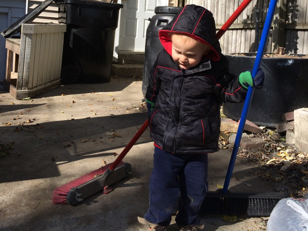 Here's a picture of Derek sweeping with two brooms, just because