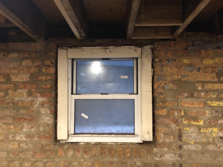 Basement window window well ideas basement eclectic with for Basement window replacement