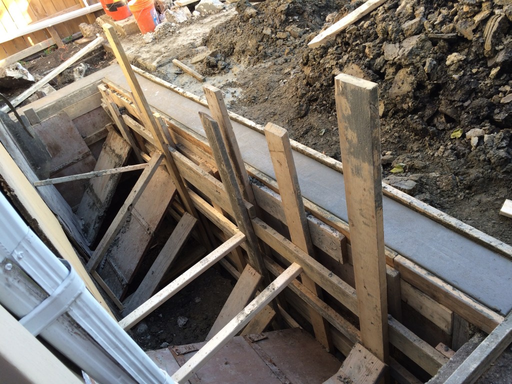 Retaining wall, formed, braced, and poured